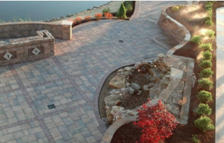 Picture of a commercial pavers project along the side of a city lake, including retention walls and walkways.