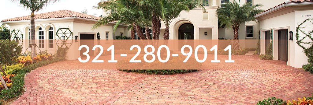 Photo of circular driveway with red brick pavers, click to call image with Brevard Pro Pavers phone number.