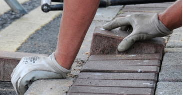 Pavers Contractor laying bricks on a commercial project.