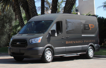 Brevard Pro Pavers company van used for hauling supplies and equipment to job sites.